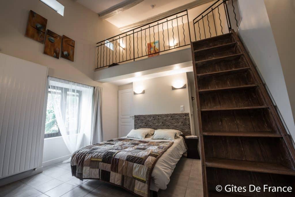 La chambre Icare de la Maison d'hôtes Altamica avec vue sur le palmier